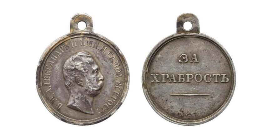 Срібна медаль «За старанність» та срібну медаль «За хоробрість»